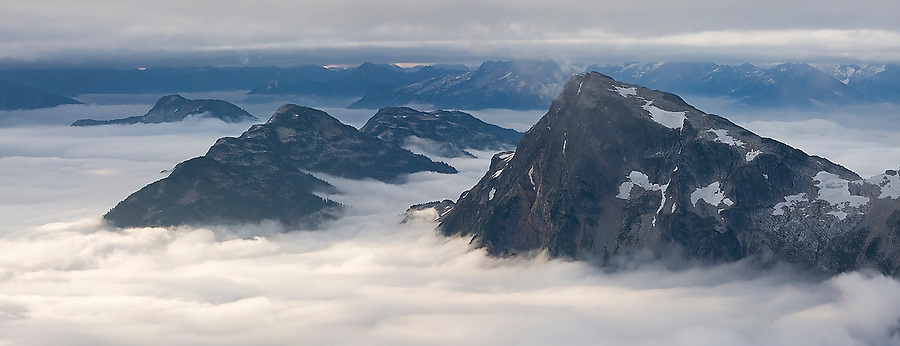 Seen from Luna Peak, Elephant Butte towers above a thick fog layer in North Cascades National Park, Washington. The view from the summit of Luna Peak is considered by those who have ventured there the most spectacular scenery of the Cascade Range.