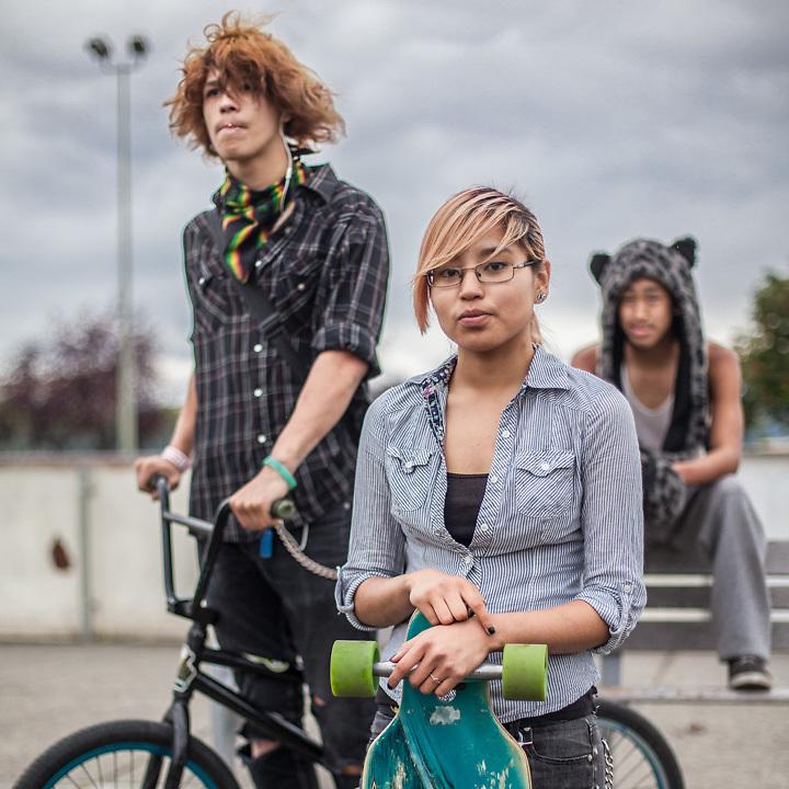 Audrey Arca (16) and Brandon Kinneeveauk (17) with their friend Cody Kiminock on Delaney Park Strip, Anchorage