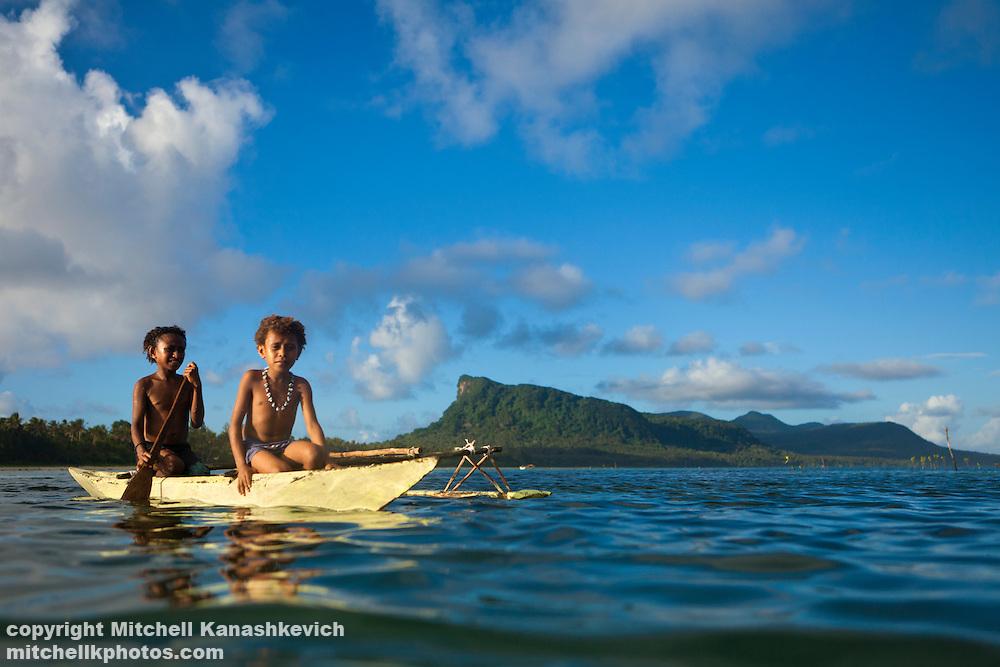 Young Ni Vanuatu girls cross the lagoon that separates Rah and Mota Lava Islands. Banks Island group, Torba province, Vanuatu.