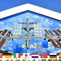 International Space Station Mural at Kennedy Space Center in Titusville, Florida<br /> In the 1960&rsquo;s, the space race had only two serious contenders.  Now, the International Space Station is a cooperative effort among the U.S., Russia, Japan, Canada and some European countries.  Since its launch in 1998, it was assembled and looks like a giant Erector Set that was popular when I was a kid.  This marvelous satellite, which is expected to be used until 2028, is painted on the Exploration Space Building at Kennedy Space Center.