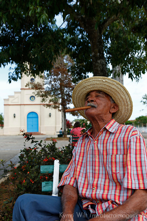 Central America, Cuba, Vinales. Local Cuban man with cigar in park.