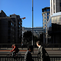 UK. London. CCTV cameras on London Bridge in Central London..In the UK the use of Closed Circuit Television (CCTV) for surveillance and crime control has grown to unprecedented levels making the UK the most ?watched? nation on earth. Between £150 and 300 million per year is now spent on a surveillance industry involving an estimated 300,000 cameras, covering shopping areas, housing estates, car parks and public facilities. .