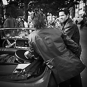 Rockers in down town Amsterdam standing by their convertible smiling after a police stopped their unexpected outdoor consert