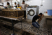 An Egyptian Coptic Christian man cries near the coffin of his brother as mourners prepare to bury victims of sectarian violence October 10, 20011 at the Coptic Hospital in Cairo, Egypt. At least 26 people, mostly Christian, were killed during sectarian clashes that saw the worst violence since the Revolution that toppled former Egyptian president Hosni Mubarak earlier this year. Egyptian Coptic Christians make up about 10% of Egypt's 80 million population and periodically violence flares between the Christian minority and the majority Muslim population. (Photo by Scott Nelson)