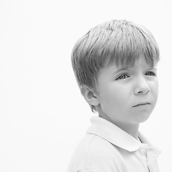 Black and white portrait photograph of sad bullied boy
