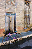 House and bicycle in Cardenas, Matanzas, Cuba.