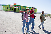 Roxanne, left, and George Skillas, center, of Florida, walk down main street accompanied by tour guide Gabriel Ureste, right, on May 15, 2015. Most visitors come for a few hours to buy handmade crafts and eat a meal. A few rooms are available to rent overnight and tours into the old mines of the Sierra del Carmen mountains draw the occasional multiple-day visitor.