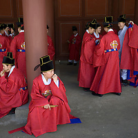 South Korea, Seoul,  Actors in historical period costume prepare for re-enactment of royal procession at Changgyeonggung, one five great palaces  built by the Joseon Dynasty.
