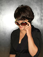 Hispanic woman (20-30) with sunglasses.