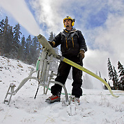 Loveland Ski Area trail maintenance and snowmaking manager Mark Abrahamson checks the quality of snow and repositions snowmaking equipment early in the morning on Wednesday October 5, 2005. With temperatures finally consistently cold enough to make snow the ski area has started making snow on the trail the area hopes to have open by mid-October. Abrahamson is from Georgetown and has been working at Loveland for 18 years..(MARC PISCOTTY/ © 2005)