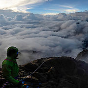 Panorama of Peter McBride and Frank Pope high on the North Face Standard Route on Mount Kenya as thunderstorms race in from the north.