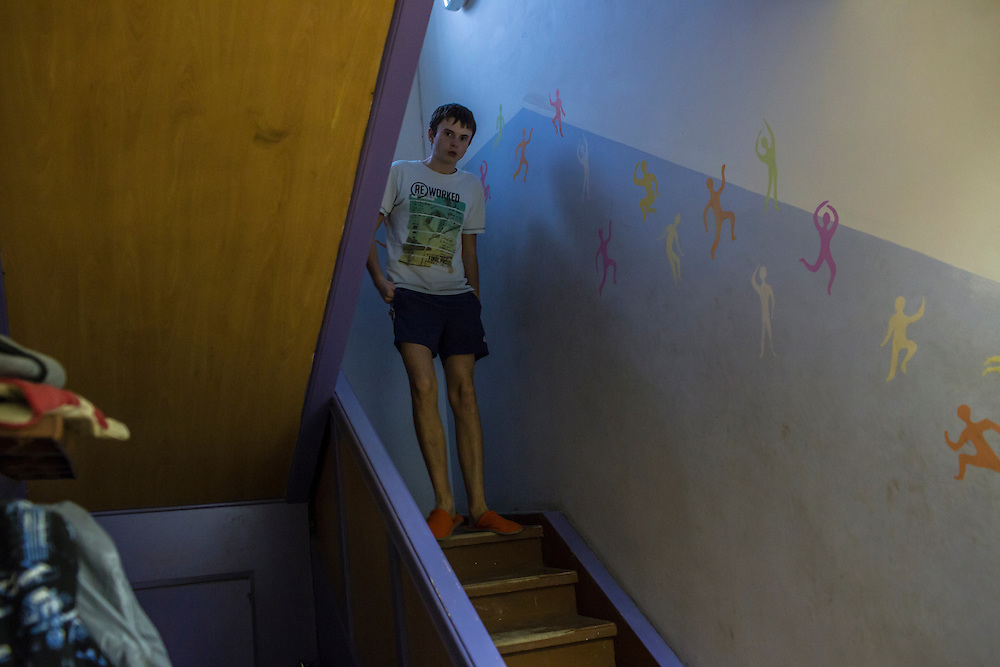 YEKATERINBURG, RUSSIA - OCTOBER 16: A boy who lives at a facility run by City Without Drugs for at-risk youth stands in the stairway on October 16, 2013 in Yekaterinburg, Russia. Nine boys, many of whom were either experimenting with drugs or had dropped out of school, live at the group home, where school attendance and homework are mandatory. City Without Drugs is a well-known narcotics treatment program in Russia founded by Yevgeny Roizman, who was elected mayor of Yekaterinburg in September 2013. (Photo by Brendan Hoffman/Getty Images) *** Local Caption ***