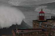 A wave is seen near the fort at North Beach during a giant swell that hit the Portuguese coast today. Brazilian surfer Carlos Burle surfed the tallest wave of the day at North Beach, Nazare, Center of Portugal, 28 October 2013. Havaiian Garrett Mcnamara's set the record for the biggest wave ever surfed on January 2013 also at Nazaré. PAULO CUNHA /4SEE
