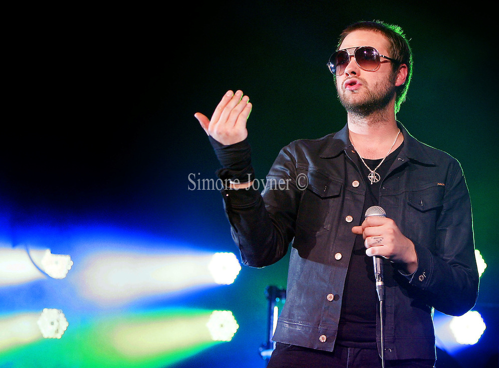 Tom Meighan of Kasabian performs live on stage at Brixton Academy on August 19, 2010 in London, England.  (Photo by Simone Joyner)
