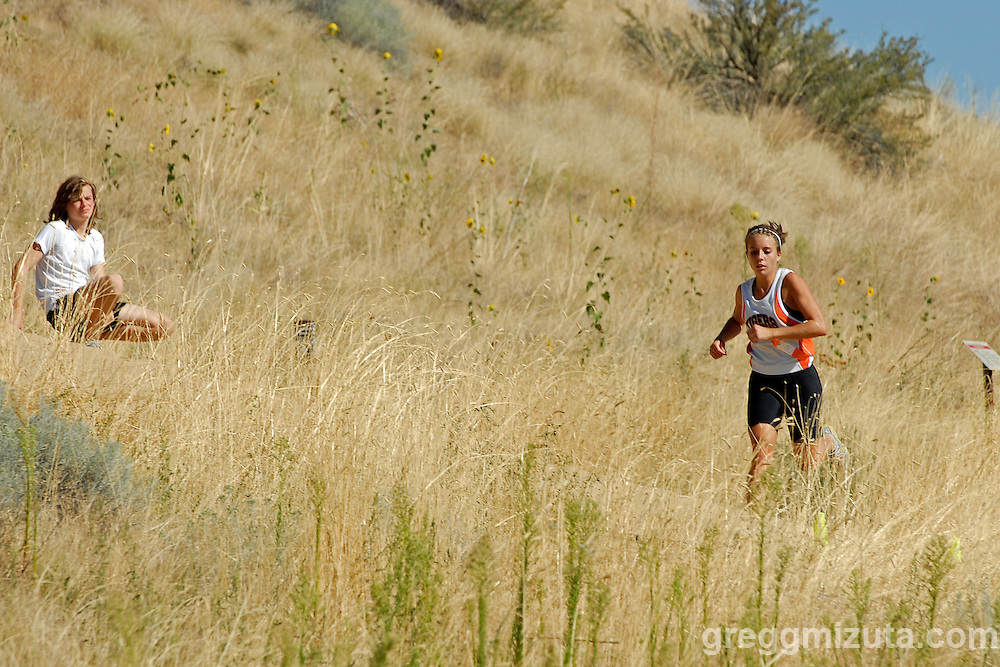 Mountain Home senior Jordan Vivier is the first girl to re-enter the park during the Camel's Back Invitational in Boise, Idaho on August 27, 2010.<br /> <br /> Vivier completed the 5k course in 21:21.13 to place first.
