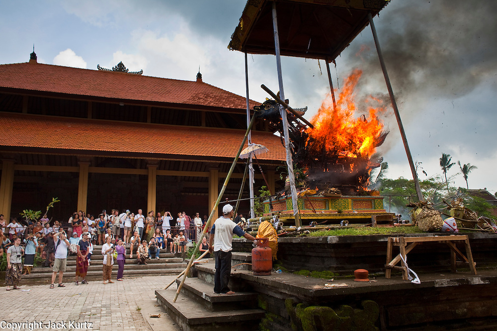 Apr. 25 -- UBUD, BALI, INDONESIA:  The bull bearing the body of Cokorde Gede Raka is set alight at his funeral. Cokorde Gede Raka, a member of Ubud's royal family, was cremated Sunday, Apr. 25. Balinese are Hindus and cremate their dead. Balinese funerals are elaborate - and expensive - affairs. A funeral for one person costs a minimum of 45 million rupiah (about $5,000 US). The body is placed into the bull's body at the cremation and cremated in the bull. The funeral pyre is burnt adjacent to the bull. That is what a family may earn in two to three years. The result is that only the rich can afford formal cremations. The body (in the casket) is placed in the top of the funeral pyre and the procession takes the body to the cremation site. The funeral pyre, and the body, are spun at intersections to confuse the spirits so the soul doesn't try to return to its home and to confuse evil spirits.    PHOTO BY JACK KURTZ