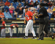 Ole Miss Head Coach Mike Bianco talks with umpire Randy Harvey vs. Auburn during the Southeastern Conference tournament at Regions Park in Hoover, Ala. on Friday, May 28, 2010.  (AP Photo/Oxford Eagle, Bruce Newman)