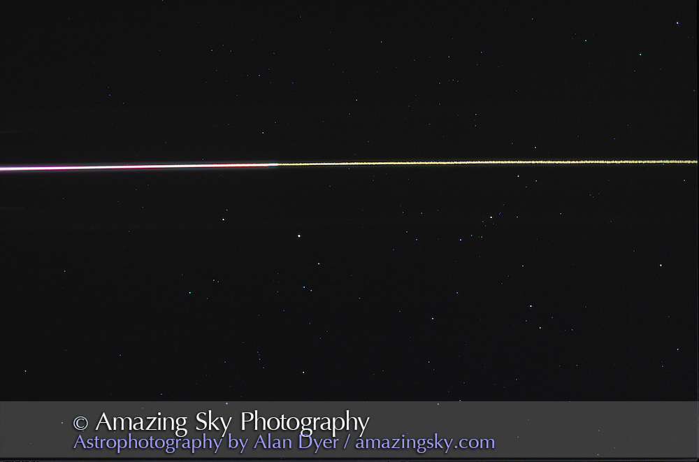 Space Shuttle Reentry<br /> September 26, 1996<br /> Reentry of STS79 over Alberta<br /> Shooting straight up -- Pink is the Shuttle itself, green is the ionized smoke trail<br /> 28mm lens f/2.8. Roughly 30 sec exposure.
