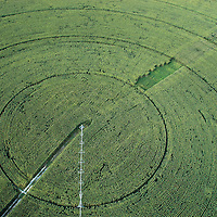 Circular pivot or king spin irrigation system, corn crops. Farmlands close to Sarin?ena, Monegros, Huesca, Spain.