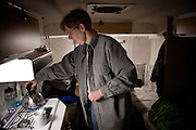 Clare Moxley makes tea in the RV she lives in while working a seasonal job at an Amazon warehouse in Fernley, Nevada, December 13, 2011. CREDIT: Max Whittaker/Prime for The Wall Street Journal.AMAZONTOWN