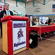 President Anthony Monaco speaks at the 2013 Region IV Science Fair at Somerville High School. (Emily Zilm for Tufts University)