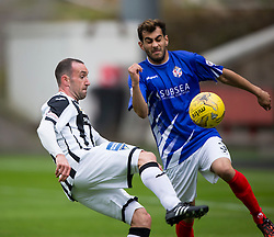 Dunfermline's Michael Moffat and Cowdenbeath's Mohammed Yakud. Half time : Dunfermline 0 v 0 Cowdenbeath, Scottish League Cup game played today at East End Park.
