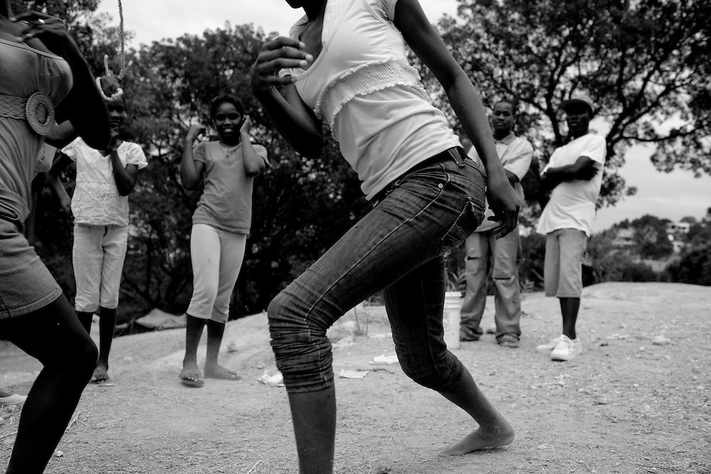 Girls skip rope in a camp for those displaced by the recent earthquake in Petionville, outside Port-au-Prince, Haiti.