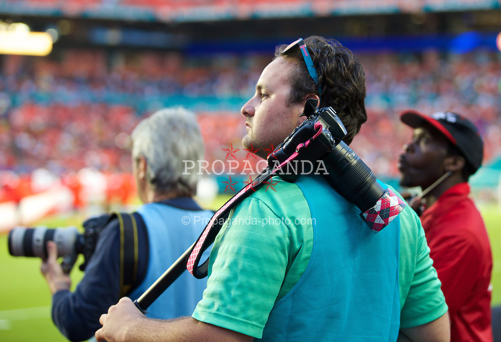 MIAMI, USA - Monday, August 4, 2014: A photographer during the International Champions Cup Final match at the SunLife Stadium on day fifteen of the club's USA Tour. (Pic by David Rawcliffe/Propaganda)