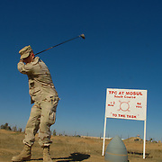 Dec 12th 2003..Quyarra, Mosul, Iraq.....Us Army Golf Course.....Lt Jesse White of the 101st Airbourne 'Task Masters' tees off on the 6 hole golf course he built at a base 50 kms south of Mosul in Northern Iraq. It is by location perhaps the most hostile course in the world and reckoned to be Iraq first and only.