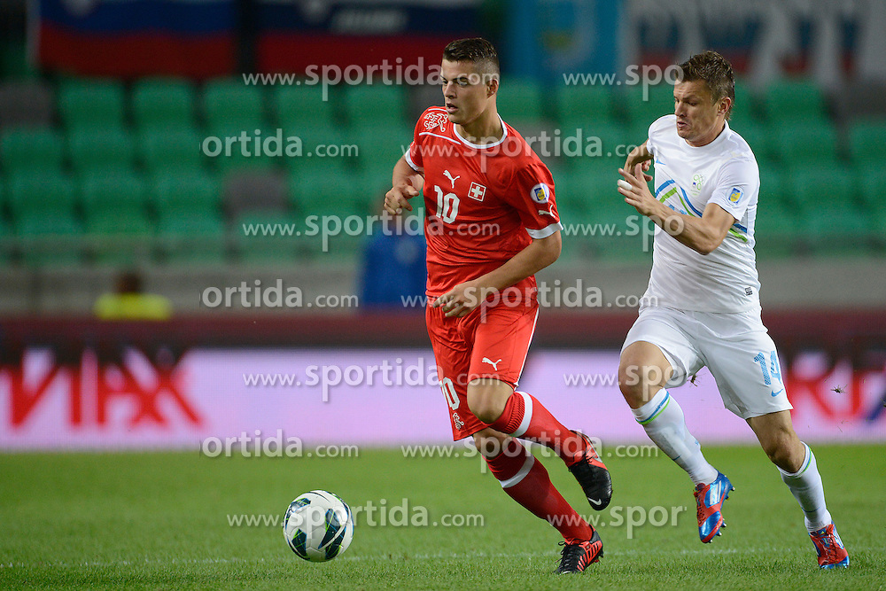 07.09.2012, Ljubljana, SLO, FIFA WM Qualifikation, Slowenien vs Schweiz, im Bild Granit Xhaka (SUI) Zlatko Dedic (SLO) // during the FIFA World Championships qualifying match between Slovenia and Switzerland, Ljubljana, Slovenia on 2012/09/08. EXPA Pictures © 2012, PhotoCredit: EXPA/ Freshfocus/ Valeriano Di Domenico..***** ATTENTION - for AUT, SLO, CRO, SRB, BIH only *****