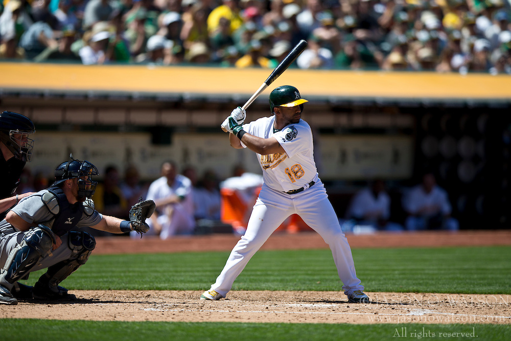 OAKLAND, CA - MAY 26:  Alberto Callaspo #18 of the Oakland Athletics at bat against the Detroit Tigers during the fifth inning at O.co Coliseum on May 26, 2014 in Oakland, California. The Oakland Athletics defeated the Detroit Tigers 10-0.  (Photo by Jason O. Watson/Getty Images) *** Local Caption *** Alberto Callaspo