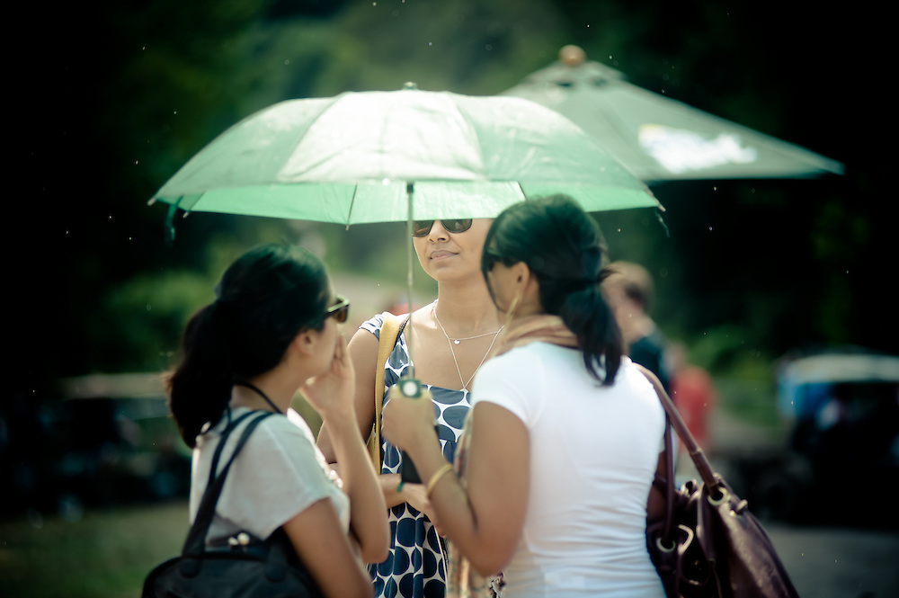 The day's only showers  fall on Noelle Trent, Shabani Shah, and Rina Dhalla of Washington, DC.