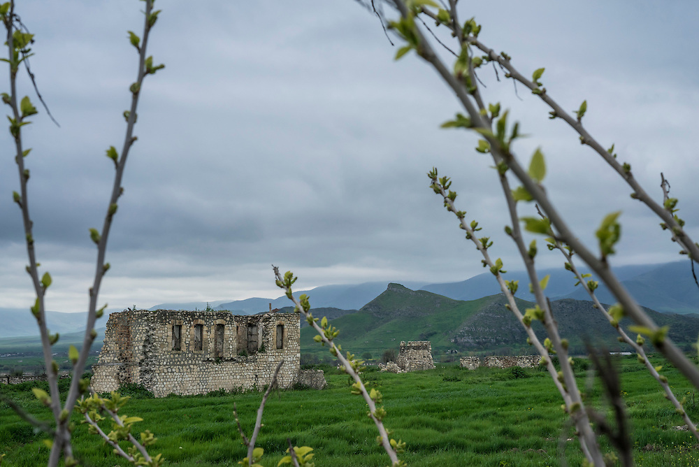ASKERAN, NAGORNO-KARABAKH - APRIL 21: A building destroyed in the war more than twenty years prior remains along the highway on April 21, 2015 in Askeran, Nagorno-Karabakh. Since signing a ceasefire in a war with Azerbaijan in 1994, Nagorno-Karabakh, officially part of Azerbaijan, has functioned as a self-declared independent republic and de facto part of Armenia, with hostilities along the line of contact between Nagorno-Karabakh and Azerbaijan occasionally flaring up and causing casualties. (Photo by Brendan Hoffman/Getty Images) *** Local Caption ***