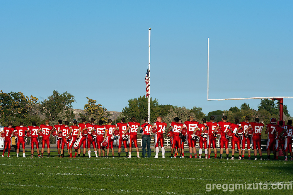 National anthem with flag at half-mast in remembrance of 9-11. Vale - Homedale football game, September 11, 2015 at Homedale High School, Homedale, Idaho. Homedale won 40-7.