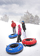 A snow tubing family on the mountain in Mammoth, California.