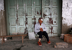 Chinese resident Chen Biying sits in front of her house after being injured during the earthquake in Lushan county of Ya'an, Sichuan Province, China, 21 April 2013. The Lushan Earthquake in Sichuan Province on 20 April 2013 resulted in 186 people dead, 21 missing, 11248 injured. About 1.72 million people were affected by the quake, while an initial estimate by the International Red Cross on Saturday put the number needing emergency shelter, water and food at 120,000. The China Earthquake Administration (CEA) recorded a magnitude 7.0 earthquake, while the US Geological Survey said it had measured 6.9.