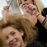 04/20/12 Newark Del. Stylist Lindsay Alvarez works on model Emily Alvarez hair during a dress rehearsal Friday, April. 20, 2012 at The Paul Mitchell school of Delaware Friday, April. 20, 2012 in Newark Del...Special to The News Journal/SAQUAN STIMPSON