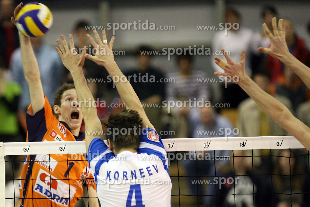 Tine Urnaut of ACH Volley, Slovenia vs Korneev at Indesit European Champions League match between ACH Volley from Bled, Slovenia and Dinamo Moscow, Russia at the Hala Tivoli on January 23, 2008 in Ljubljana, Slovenia. ACH Volley : Dinamo Moscow 0:3. (Photo by Vid Ponikvar / Sportida)
