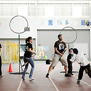Medford and Somerville children play quidditch in Gantcher Center at Kids Day 2012. (Matthew Modoono for Tufts University)