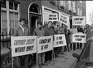 """Farmers Protest in Kildare Street,Dublin..1985..01.02.1985..02.01.1985..1st February 1985..Photograph of Farmers protesting outside the offices of the legal firm of Whitney,Moore and Keller where tenders for the """"Clover"""" assets were being submitted..In Nov 1984 Clover Meats closed with a loss of 600 jobs. Farmers who had supplied cattle to the factory were not paid for deliveries. As the assets were to be sold off, farmers demanded that they be paid the outstanding £2,000,000..Mr Michael Slattery,Munster Vice-President IFA,Mr Laurence Carroll,Chairman,Clover Farmers Creditors and Mr Tom Kearny,Executive Member,ICMSA led the protest."""