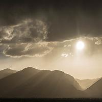 The sun begins its descent behind the Teton Range near Jackson, Wyoming