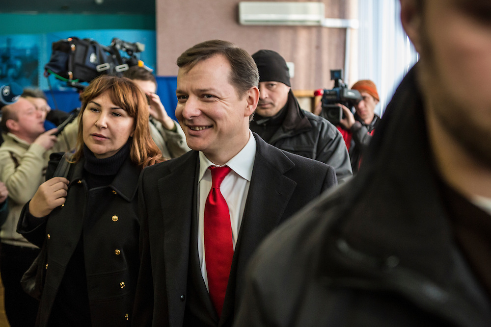 KIEV, UKRAINE - OCTOBER 26: Oleh Lyashko (C), head of Ukraine's Radical Party, and his wife Rosita Sayranen (L) leave after casting their ballots at a polling station on October 26, 2014 in Kiev, Ukraine. The country's parliamentary elections are seen as key to President Petro Poroshenko's ability to advance his agenda. (Photo by Brendan Hoffman/Getty Images) *** Local Caption *** Oleh Lyashko;Rosita Sayranen