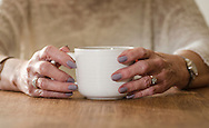 Elderly Womans Hands Holding a Cup - Jan 2016