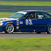 Bock &amp; Picut drivers of the No. 03 BMW 330 speeds down the straightaway during qualifying Friday, July 22, 2011, at New Jersey Motorsports Park in Millville New Jersey.<br />