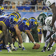 Delaware and Jacksonville line up at the line of scrimmage during a Week 1 NCAA football game between Delaware and Jacksonville University. <br /> <br /> Delaware defeated Jacksonville University 51-35 in their home opener at Delaware Stadium Thursday Aug. 29, 2013 in Newark Delaware.<br /> <br /> Delaware will return home Sept. 7, 2013 at 3:30pm for a showdown with interstate Rival Delaware State in the Route 1 Rivalry Bowl at Delaware Stadium.