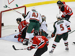 Mar 20, 2009; Newark, NJ, USA; New Jersey Devils left wing Patrik Elias (26) scores his second goal of the game past Minnesota Wild goalie Josh Harding (29) during the third period at the Prudential Center.  The Devils defeated the Wild 4-0.