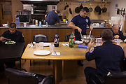 Probationary fire fighter Andres Godoy, left, FF John Palombini, back,  veteran and FF Kamil Mizinsky, center, FF Greg Kemp and Capt. Bill Laban, far right, have dinner at the 16th Street Fire House of the North Hudson Regional Fire and Rescue in Union City, NJ on November 07, 2013. Probationary FF Andres Godoy, left, was having his second day at the 16th Street Fire House even though he'd been on probation for six months. Probationary fire fighters rotate through the fire houses through their first year. FF Greg Kemp has been at the 16th Street Fire House since he became a fire fighter 24 years ago.