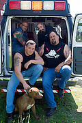 "Rescue Ink, Long Island, New York, taettowierte Motoradgang, Verein zur Rettung mishandelter Hunde und anderer Tierarten.vlnr:.Jonny ""O"", ""Batzo"", Joe Panz, ""Big Ant"",und Rebel  in ihrem Krankenwagen.Rescue Ink, the animal rescue group that brings an in your face approach to the fight against animal abuse and neglect. The goups members are heavily tattooed and ride motorbikes. Their pitbull 'Rebel', who lives at their headquarters, was rescued from a dog fighting operation, where he was used as bait. He was near death when two members of Rescue Ink flew to Virginia to save him...Foto © Stefan Falke."