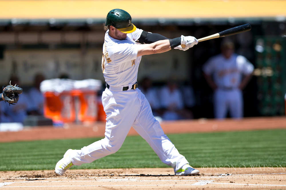 OAKLAND, CA - MAY 26:  Josh Donaldson #20 of the Oakland Athletics at bat against the Detroit Tigers during the first inning at O.co Coliseum on May 26, 2014 in Oakland, California. The Oakland Athletics defeated the Detroit Tigers 10-0.  (Photo by Jason O. Watson/Getty Images) *** Local Caption *** Josh Donaldson