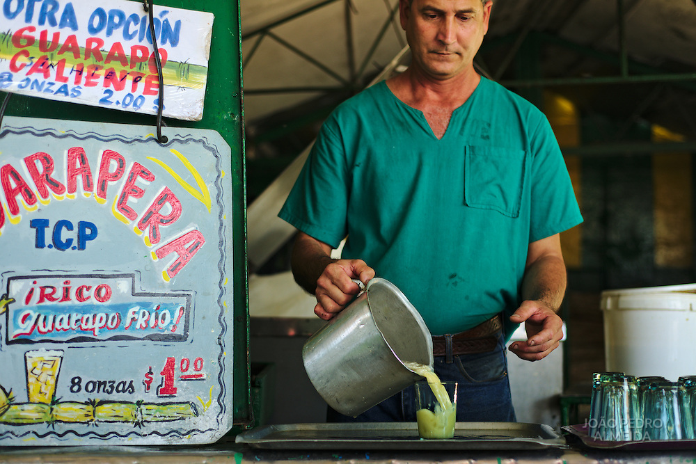 Selling guarapo. the sweet, cold sugar cane juice